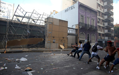 Protesters pull down a scaffold to build a barricade during clashes with police outside the Congress in Buenos Aires