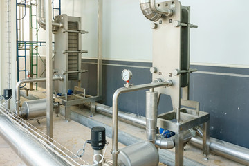 metallic plate in heat exchange machine and pump in the food industrial plant