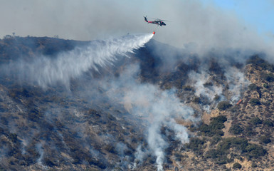 Firefighters continue to battle the Thomas fire , a wildfire near Fillmore, California