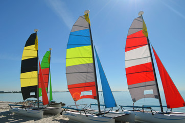 Small sailing catamarans resting in the sand on a beach in Key Biscayne,Florida