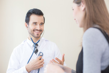 Doctor using stethoscope with attractive smiling. People with medical concept.
