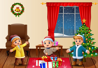 Happy kids in the living room with christmas and new year decoration