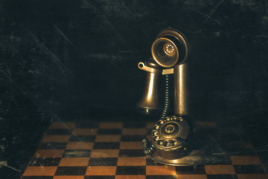 Retro candlestick telephone  set on a chess game photography with created artifacts