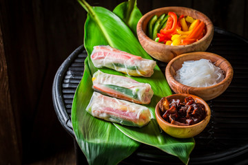 Preparing spring rolls with sweet and sour sauce