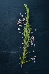 Rosemary and spices. On a wooden background. Free space for your text. Top view.
