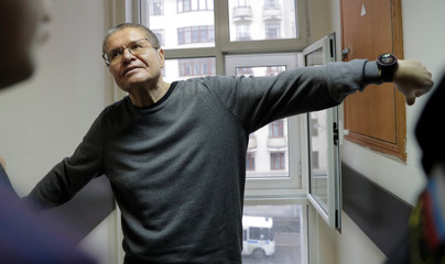 Russian former economy minister Alexei Ulyukayev waits for the start of a court hearing in the court building in Moscow