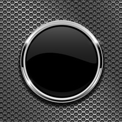 Black round glass button with chrome frame on metal perforated background