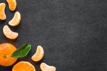 Beautiful, fresh, orange mandarins on the dark background. Healthy sweet food concept. Mock up for fruits offers as advertising or web background, or other ideas. Empty place for text or logo.