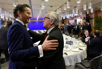Outgoing Eurogroup President Dijsselbloem and European Commission President Juncker attend a European Union leaders summit in Brussels