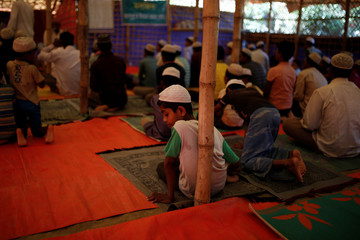 Rohingya refugees attend Friday prayers at a self-made mosque at the Balukhali refugee camp near Cox's Bazar