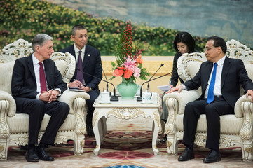 China's Premier Li Keqian talks with Britain's Chancellor of the Exchequer Philip Hammonds at the Great Hall of the People in Beijing