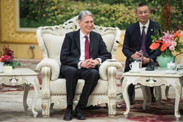 Britain's Chancellor of the Exchequer Philip Hammonds talks with and China's Premier Li Keqian at the Great Hall of the People in Beijing