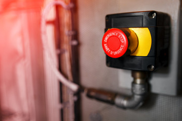The red emergency button or stop button for Hand press. STOP Button for industrial machine, Emergency Stop for Safety.