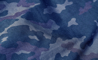 Blue and brown color military uniform pattern with blur effect.