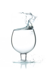 A glass of water, a splash of water