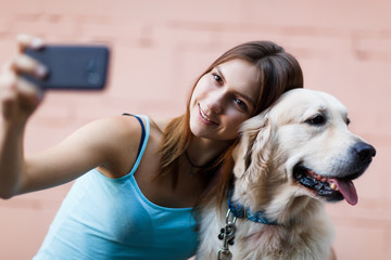 Photo of woman doing selfie with dog