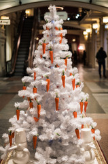 Picture of white Christmas tree decorated with carrots
