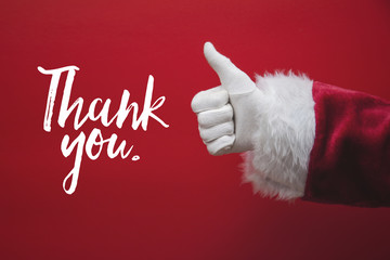 Santa Claus hand thumbs up with a festive message