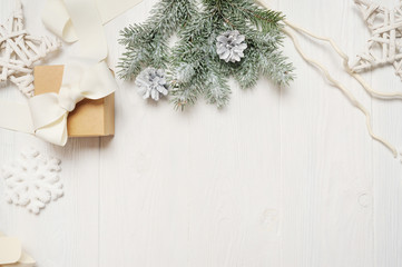 Mockup christmas or new year frame composition with space for your text. christmas decorations on white wooden background. holiday and celebration concept for postcard or invitation. top view