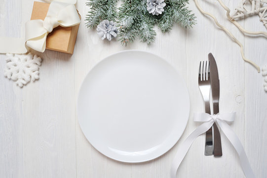 Christmas table setting on white wooden table. Christmas card template with space for your text, top view