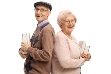 Elderly man and an elderly woman with books