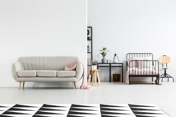 Girl's bedroom with beige sofa