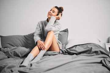 Girl sitting on bed in the morning