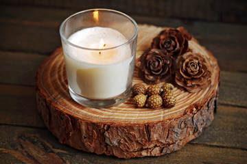 white candle on wood