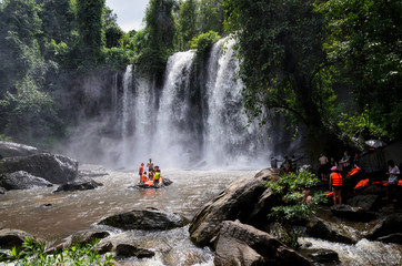 SIEM REAP, CAMBODIA - October 16, 2015: Local people swimming at Phnom Kulen waterfall in Phnom Kulen National Park , Cambodia