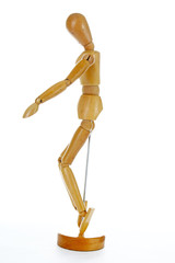 Wooden mannequin drawing model human shape. Doll human body figurine statue pose posing to illustrate human body positures for draw class or every concept. Body statue.