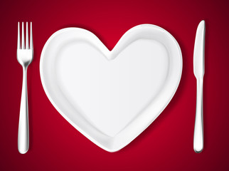 Vector plate in shape of heart, knife, fork