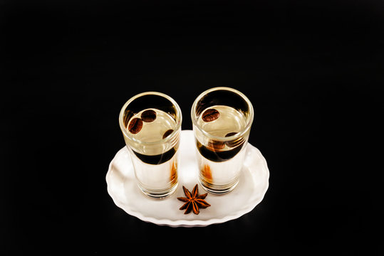 aromatic anise alcohol with coffee beans in a glass, drink set