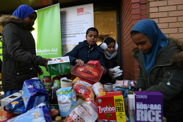 Volunteers at the East London Mosque, in conjunction with Muslim Aid, pack food, that has been donated by people of all faiths, to feed homeless at Christmas in London