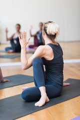 Women practicing yoga together