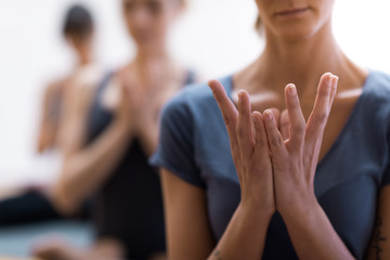 Women practicing yoga and meditation