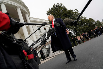 U.S. President Donald Trump talks to the media on South Lawn of the White House in Washington