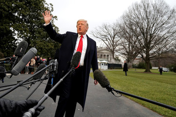 U.S. President Donald Trump waves after speaking to the media on South Lawn of the White House in Washington