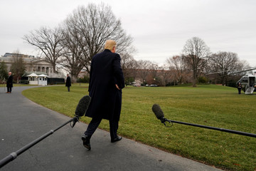 U.S. President Donald Trump walks out after speaking to the media on South Lawn of the White House in Washington