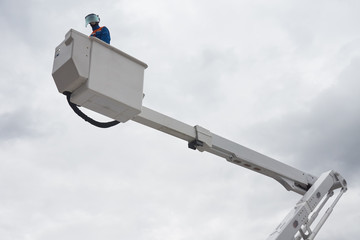 An electrician on aerial platform