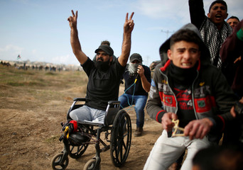 Wheelchair-bound Palestinian demonstrator Ibraheem Abu Thuraya, who according to medics was killed later on Friday during clashes with Israeli troops, gestures during a protest, near the border with Israel in the east of Gaza City