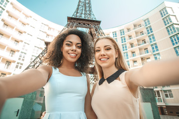 Young women travel together paris vacation abroad