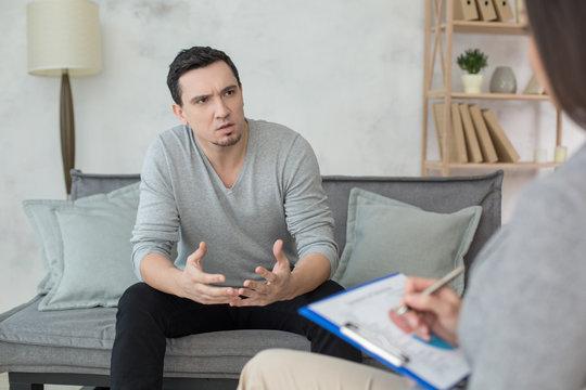 Man visit psychologist meantal health care stress