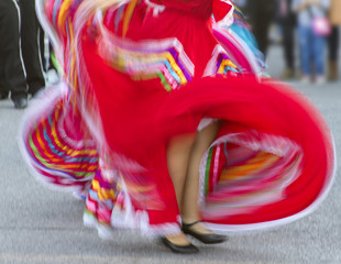 swirling red Mexican dance costumes