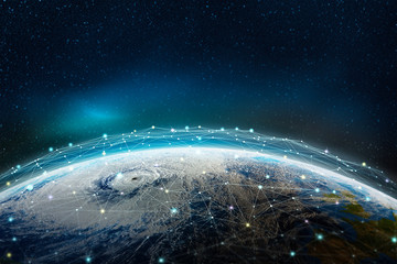 A global social, information network across the planet. The earth is surrounded by a web of digital data. Elements of this image furnished by NASA