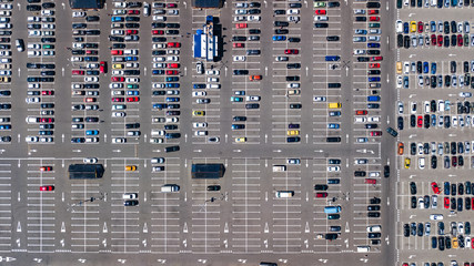 Aerial top view of parking lot with many cars from above, city transportation and urban concept