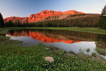 Wall Mural - UInta mountain sunrise reflection, Utah, USA.