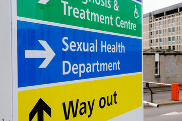 Sign for the Sexual Health Department outside a hospital