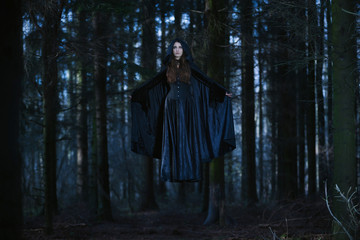 Witch levitating in the forest