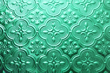 Colorful seamless texture. Glass background. Interior wall decoration 3D wall pattern abstract floral glass shapes background for any id card business card concept. Retro colored window glass. Green.