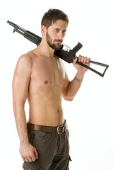 Man with a beard of a bandit with a naked torso with a Kalashnikov rifle on white background